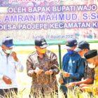 H. Amran Mahmud didampingi Kadis Pertanian dan Kertahanan Pangan Ashar menghadiri dan panen raya padi di Dusun Masiae, Desa Paojepe, Kecamatan Keera, Jumat (27/8/2021).